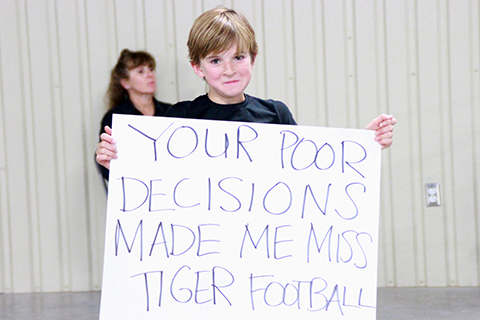 A student laments missing Tiger football's opening playoff game for the TCEQ permit meeting. (photo by Samantha Smith)